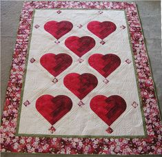 "Laura made this beautiful quilt with gorgeous quilting. The pattern is ""Love your log cabin."""