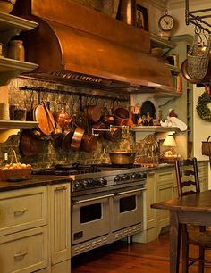 Paula Deen's Sprawling Savannah Mansion Is for Sale. The cook's kitchen is outfitted with a Viking range and a broad copper hood. Kitchen Stove, Copper Kitchen, New Kitchen, Kitchen Dining, Kitchen Pics, French Kitchen, Kitchen Ideas, Kitchen Cabinets, Restaurant Chalet