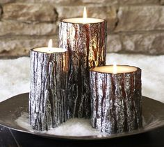 White and Silver Decor For a Modern, Wintry Style: Silvery accents give the Metallic Bark Pillar Candles ($10-$23, originally $13-$30) a glamorous look.