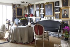 In the living room of John Mayberry's San Francisco apartment, he and his designer, Antonio Martins, deployed Mayberry's collection of portraits as three-dimensional wallpaper. Unexpected touches, such as a modern stainless steel mobile and a stone garden seat that Martins gave his client, help the scheme feel fresh.