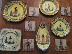 Collectors items: tiles and pottery showing the different tints of old Quimper pottery