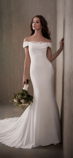 """* Adrianna Papell l """"Penelope"""" l This crepe gown features a beautifully draped neckline and off the shoulder detail. Lace peaks out from the neckline for an added detail."""