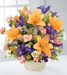 This garden bouquet displays the bright colors of nature. Arrangement includes orange lilies, purple iris and dainty white daisies, with pink mini carnations and yellow solidago at $77.90  http://www.bboescape.com/products/buy/736/say-it-with-flowers/FTD-Natural-Wonders-Bouquet