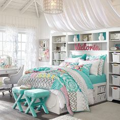 -Love the desk, curtains, stools, colors, bedspread, chandelier, underbed storage, and around the bed storage-