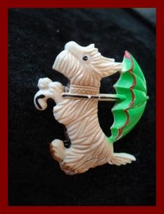 even our dogs need umbrellas --Vintage Czechoslovakian Art Deco Scotty Terrier Umbrella Plastic Brooch