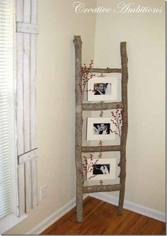 Branch ladder made to hang pictures.