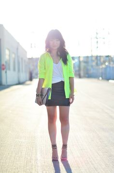 Cool rocker chick look, neon cardigan, side knot white tee, black leather skirt,  black studded sandals, black clutch
