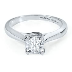Diamond Masterpiece 1ct TW Engagement Ring in 18K Gold        18 karat white gold Helzberg Diamond Masterpiece® solitaire engagement ring with a square cut diamond weighing approximately 1 carat TW      Accompanied by an AGS grading report    $11,999.00