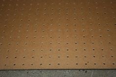 Pegboard. Very fashion! Such style! For where the bookshelves are now. Keep my shoeses there.