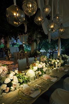 Elegant, love the lighting.   Wedding Reception. #Long Table Setting. #Wedding Centerpieces #Table Arrangements. #Wedding Flowers. #Outdoor Wedding Tent. #www.celebritystyleweddings.com #CelebStyleWed