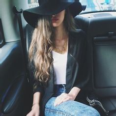 V neck t, light blue jeans and black duster jacket