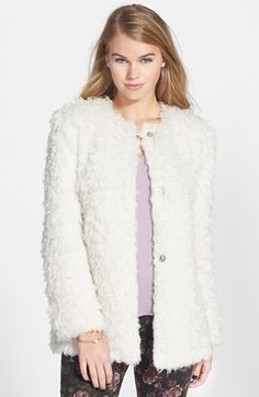 "Collection B 'Angel Hair' Faux Fur Jacket (Juniors)    Lush faux-fur construction offers touchable softness and cozy warmth to a statement-making oversized jacket.      28"" length (size Medium).     Front snap closure.     Lined.     100% polyester.     Dry clean.     By Collection B; imported.     BP."