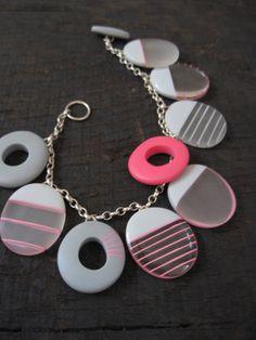 grey and cerise pink resin charm bracelet.