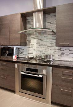 kitchen glass chimney hood  gray backsplash