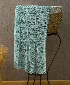 Learn how to crochet the Andante crochet throw with this free, easy to crochet afghan pattern featuring decorative joined squares. This elegant lacy afghan would look beautiful on your bedspread or laying over your living room couch.