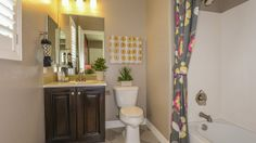 Little girls will love having a floral #bathroom design like this one by Taylor Morrison at Estates at Happy Valley. #bathroomdesign #interiorbathroom #bathe #girlsbathroom #floraldesign #floral #decor