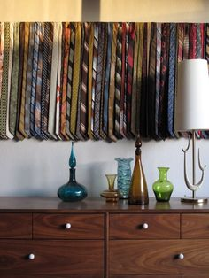 DIY: Organize your necktie collection by hanging them on a dowel along the wall; vintage necktie display / wall art