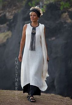 Long oatmeal linen gauze tunic Lili layered on our wild legs black linen baba pants.