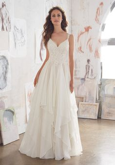 This Boho Lace Wedding Gown Beautifully Combines Romantic Layers of Flounced Chiffon and a Fitted Bodice Adorned with Venice Lace AppliquŽés.