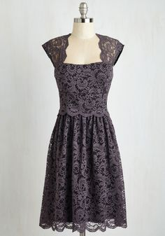 <p>The path to stylish sophistication becomes clear as soon as you don this grey lace dress! This cap-sleeved frock boasts sweet scallops along the sheer shoulders, open back, and fitted waist - a detail that ensures its delicate, A-line silhouette never gets lost in a crowd.</p>