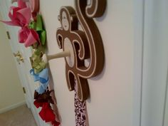 I have this from Cole's nursery...never occurred to me to add a knob for a coat hanger...