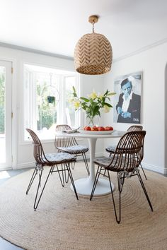 White Circular Table And Metal Framed Chairs In This Dining Room Design