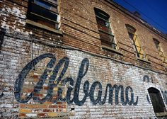 Alabama script mural on distressed building in Birmingham (photography)
