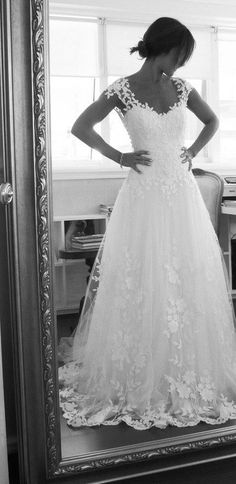 White Embroidered Tulle Low-Cut Back. Totally want this dress but with a ribbon tied up around the waist flowing down at the back :)