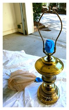 Take an old brass lamp and turn it into a DIY Mercury Glass lamp - spray paint, vinegar and water give you this beautiful - aged look