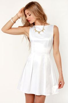 A sleek and lovely satin dress. Just as gorgeous accessorized or by itself.