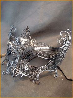Beautiful silver mask we will attend a masquerade ball one day Silver Mask, Silver Filigree, Silver Metal, Faberge Eier, Costume Venitien, Masquerade Ball, Masquerade Wedding, Silver Masquerade Mask, Costumes