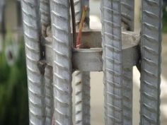 rebar trellis, spacers of cut tubing every 3 feet , 1/2 rebar, imbedded in concrete, 8 feet at center of arch!