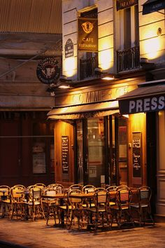 """This little 24/7 café on Rue des Petits-Carreaux was usually packed with locals and tourists sipping coffee and chatting, but on passing late one evening we found only """"Empty chairs at empty tables."""""""