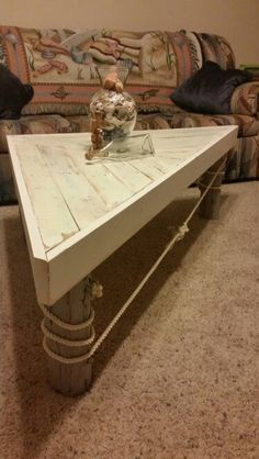 Corner shaped coffee table made from pallets. The legs I got from great aunts farm. They used to be fence post