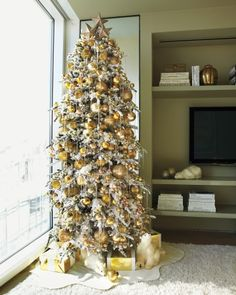 Take inspiration from our themed trees embellished with garlands, ornaments, and tree toppers.Kevin Sharkey punctuated this 10-foot-high flocked tree with golden glass balls, then added new and vintage glass icicles. Cut felt serves as a tree-skirt-cum-snowdrift.Pre-lit heavy flocked spruce (similar to shown), 9', $485, homedepot.com.