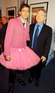 How can I not repin David Tennant in a tutu?... it is impossible<<THE PINK SUIT THOUGH<<Did you guys notice that the colour is Rose?