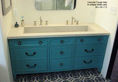 I like the color vanity and the tile on the floor. Trough in a bathroom seems excessive. Trough elsewhere - good idea.