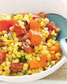 Grilled Corn and Tomato Salad. Great for summer because it's best prepped ahead of time and served at room temp. Grill 3 ears corn & cut kernels off cob. 1 beefsteak tomato, 1 orange bell pepper, 2 scallions, 1-2 Tb red-wine vinegar, 1 Tb olive oil, course salt and ground pepper. Martha Stewart Recipes.