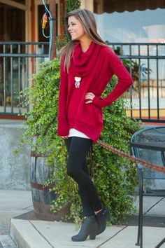 """Call me crazy, but is this red sweater not a must-have for the season? That dramatic cowl neck is super trendy and the loose fit makes it easy to layer over anything!   Bra-friendly! Material has generous amount of stretch.  Miranda is wearing the small.   Length from shoulder to hem: S- 34""""; M- 35""""; L- 36""""."""