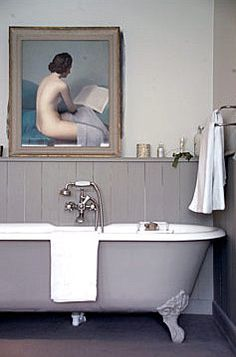 Grey sided claw foot tub with beautiful art.