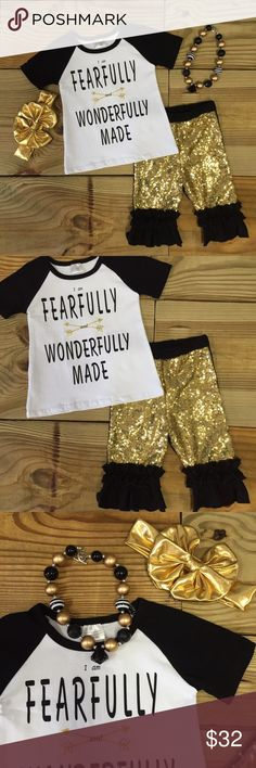 """Fearfully & Wonderfully Made"" Gold Sequin Outfit Our girls black and gold sequin outfit has ""Fearfully & Wonderfully Made"" in text on the top with black and gold sequin ruffled capri pants. The bottoms have sequin on the front and cotton fabric on the back side. Lined for comfort. Totally trendy! Accessories are included in this set! Grab one now for ""back to school"", vacation, photo shoots, pictures, and everyday wear! Fits TRUE TO SIZE 97% Cotton 3% Spandex Sizes are limited and going…"