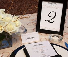 Formal gold and black wedding reception table setting with customized wedding menu, place card and table number.  | Invitations by Ajalon | invitationsbyajalon.com