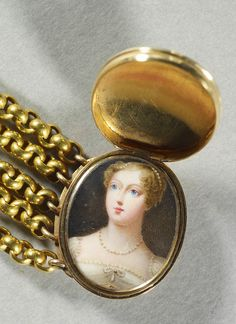Hinged gold bracelet clasp, the band of six chain links, the lid engraved with Princess Charlotte's coronet and initials, containing a miniature of Princess Charlotte of Wales, head and shoulders, wearing a white dress with a pearl necklace and pendant brooch at her corsage, her hair dressed with pearls.