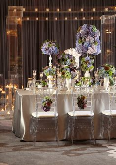 Simple elegance at The Ritz-Carlton, Buckhead: Subtle linens are luxurious when combined with strong florals in multiple sizes and shapes.