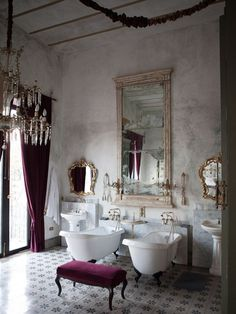 2 SINKS AND 2 BATHS! Because why not? That's a massive room anyway. Kind of French style bathroom, mostly white with accents in plum