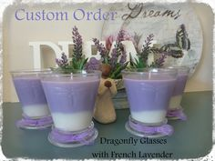 Custom Order  Gorgeous Dragon Fly Glasses which have two layers of French Lavender and finished with a cute little bow.  These were a surprise gift and winged their way to Sydney.  www.facebook.com/dreamcandles4740