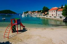 The beach in the cove of Brna, island of Korčula. Photo by Dino Cetinić