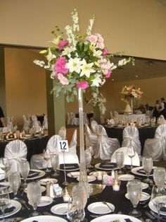eiffel tower flower arrangements | Lily & rose arrangement in eiffel tower Wedding reception arrangement ...