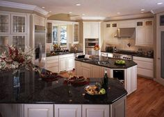 white kitchen cabinets with black countertops image of white kitchen cabinets with black granite antique white kitchen cabinets with dark granite countertops Dark Granite Countertops, Black Kitchen Countertops, Cream Kitchen Cabinets, Black Granite, Kitchen Paint, Black Counters, Kitchen Worktops, Granite Tile, Black Marble