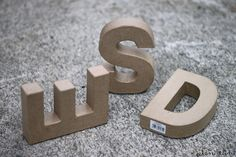 DIY concrete letters -- Instructions are in Finnish but you can have Google translate the page for you. Idea to use same technique with other paperboard shapes as molds.